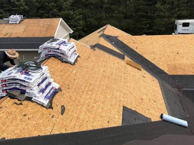 View of the roof decking after stripping off the old shingles.