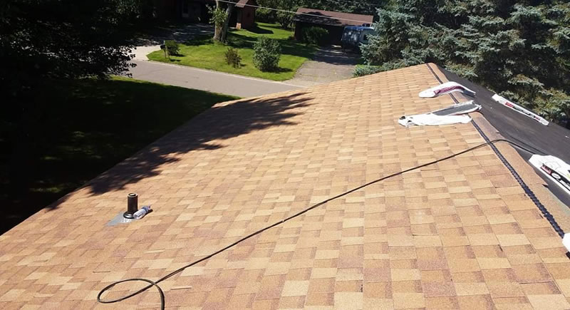 Thunderstruck Restorations Completed This Roof Replacement In Arden Hills MN Using Atlas Pinnacle Shingles in Desert Tan Color.