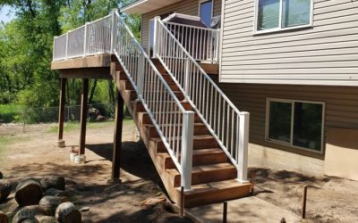 12 x 20 Brown Treated Wood Deck Built By Thunderstruck Restorations LLC In Ham Lake, MN.