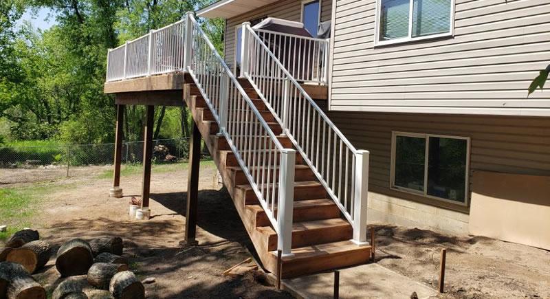 12 x 20 Brown Treated Wood Deck Built By Thunderstruck Restorations LLC In Ham Lake, MN.